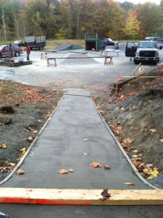 temporary fencing keeps skaters off wet cement.  When cured, fencing is removed and the park is ready to skate.