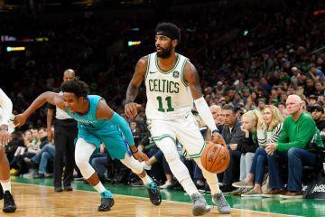 Kyrie irving avec le maillot des Celtics en pré-saison