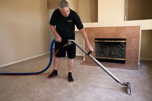 man as carpet cleaning