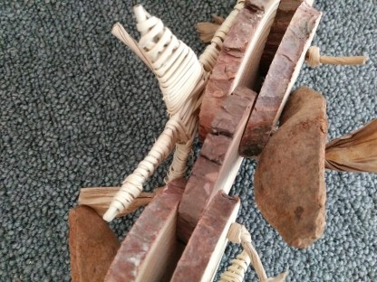 natural bird toy with wood chunks