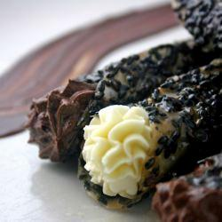 Black Sesame Lace Cookie cigars with white and dark chocolate mousse.