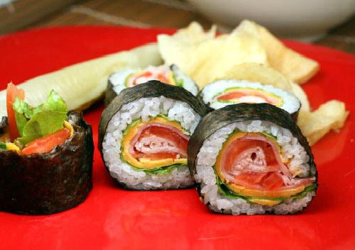 Club Sandwich Sushi Roll. Wasabi mayo, romaine lettuce, cheddar cheese, ham, tomato and turkey.