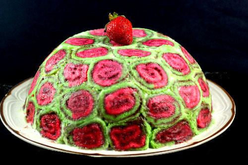 Strawberry Pistachio Swiss Swirl Cake Roll Ice Cream Cake with a Hot Fudge center!