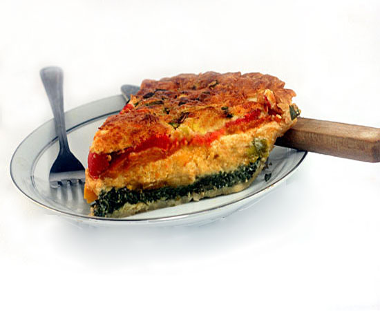 What started as a quiche, morphed into a Magic Cheesy Vegetable Omelet Pie. The pie magically forms three layers and its own top crust while baking. The center is a perfect cheese omelet!