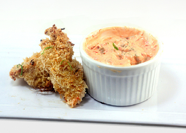 Crunchy Coconut Key Lime Oven Crisped Chicken Sticks (or chunks) with Spicy Yogurt Dipping Sauce. So crispy ad crunchy that it tastes deep-fried!
