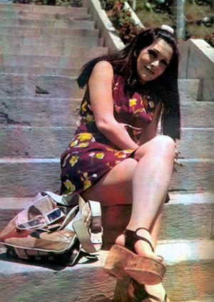 Giti Pashaei in miniskirt and high heels