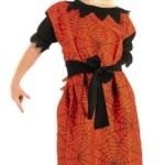 apka ve elbiseden oluşan kostüm.