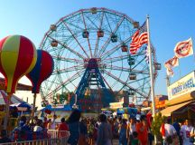 The Coney Island Wonder Wheel rises over Luna Park.