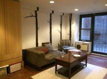 My sublet's living area, complete with tree decals :)