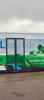 Helsinki passengers now go from aircraft to terminal on Finland-themed buses