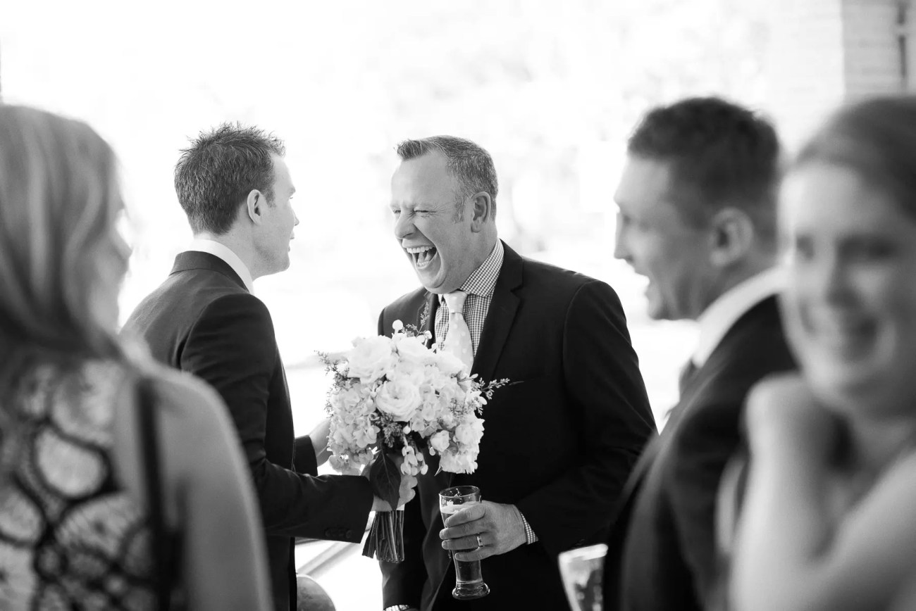 Wedding laughter at Sails on the Bay