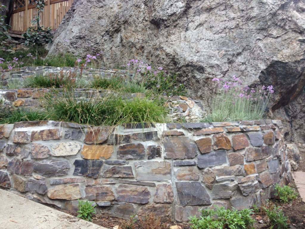 3 Stone Retaining Wall Ideas for Hillside Gardens on Patio Stone Wall Ideas  id=97588