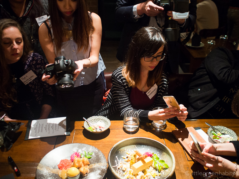 In Asia - food bloggers snapping photos of dessert