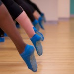 Pointed toes in arabesque at Passion Barre