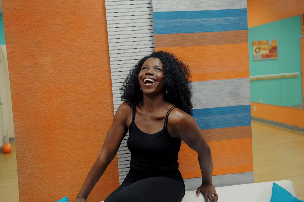 Laughing shot of Dami of Passion Barre and bydami.com streaming online workouts