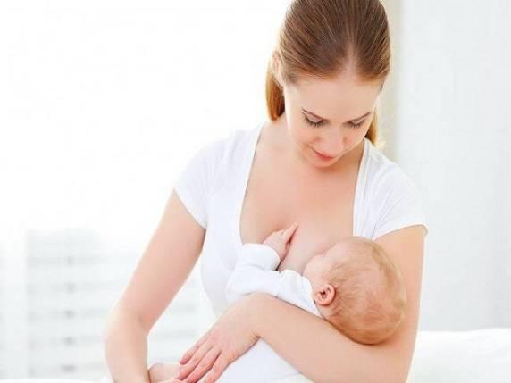 allattamento posizione a culla