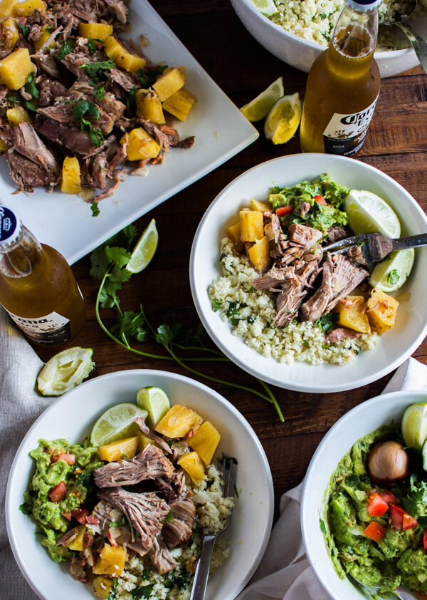 """Pineapple Pulled Pork with Cauliflower """"Rice"""" + Guacamole - Pork shoulder slow cooked with fresh pineapple, bacon, garlic, and apple cider vinegar. Then served over cilantro lime cauliflower """"rice"""" and topped with fresh guacamole. Gluten and Dairy Free. 
