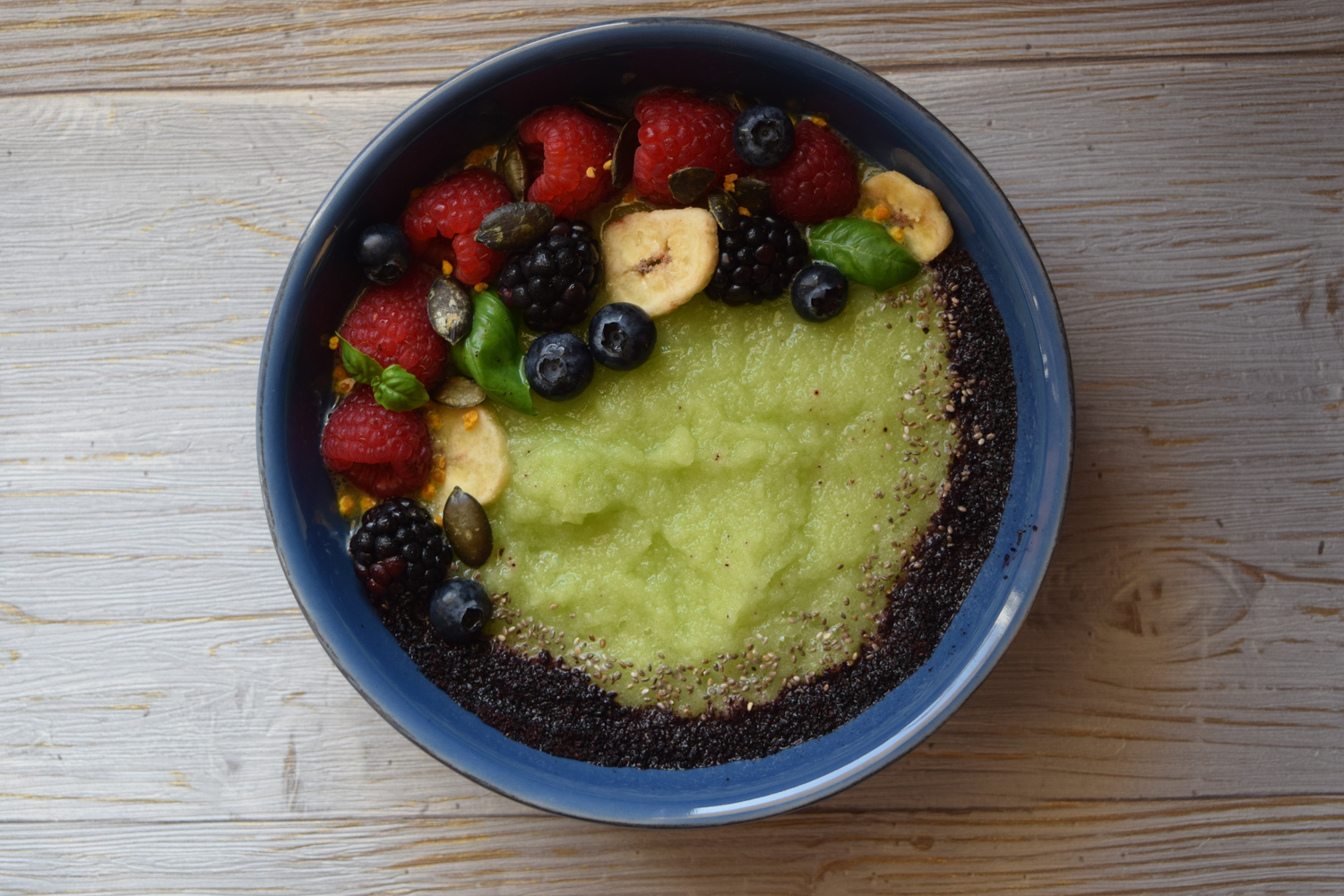 Dairy-free green smoothie bowl with green apple, celery, basil, chia seeds, fresh berries and Bilberry powder. Recipe here.