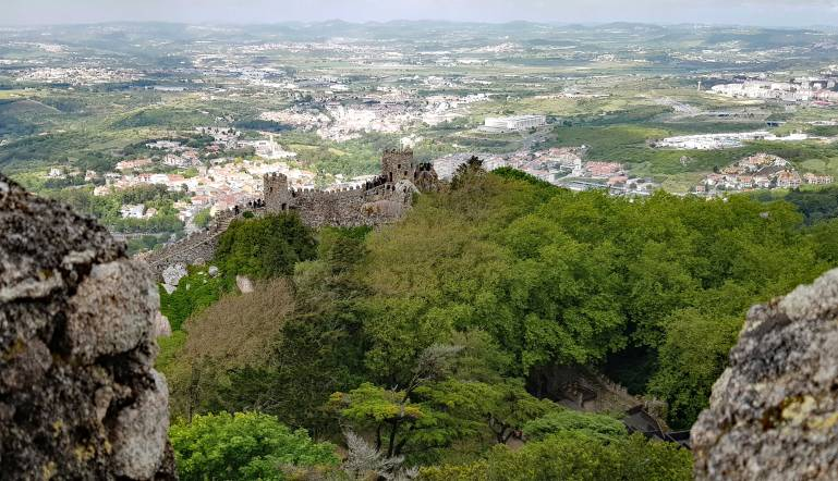Things to do in Lisbon: Battlements of the Moorish Castle in Sintra. Looking down on the valley below.
