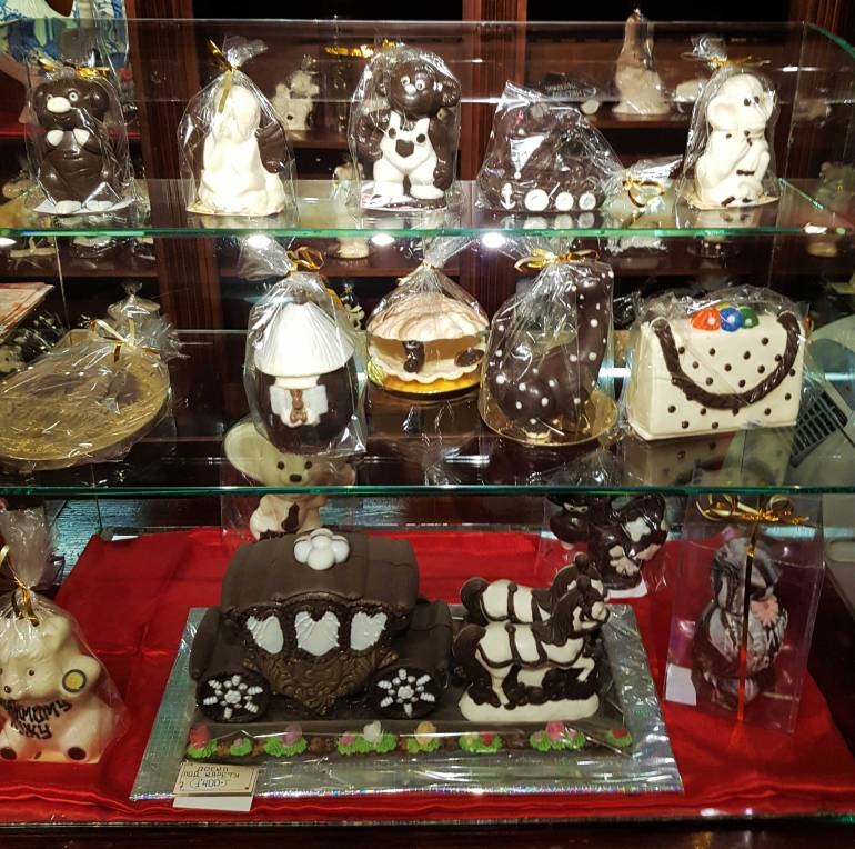 Display of chocolate in the Chocolate Museum, including a milk chocolate carriage pulled by white chocolate horses