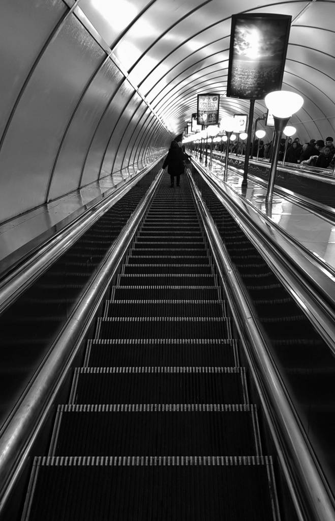 Long escalator leading down into the St Petersburg subway