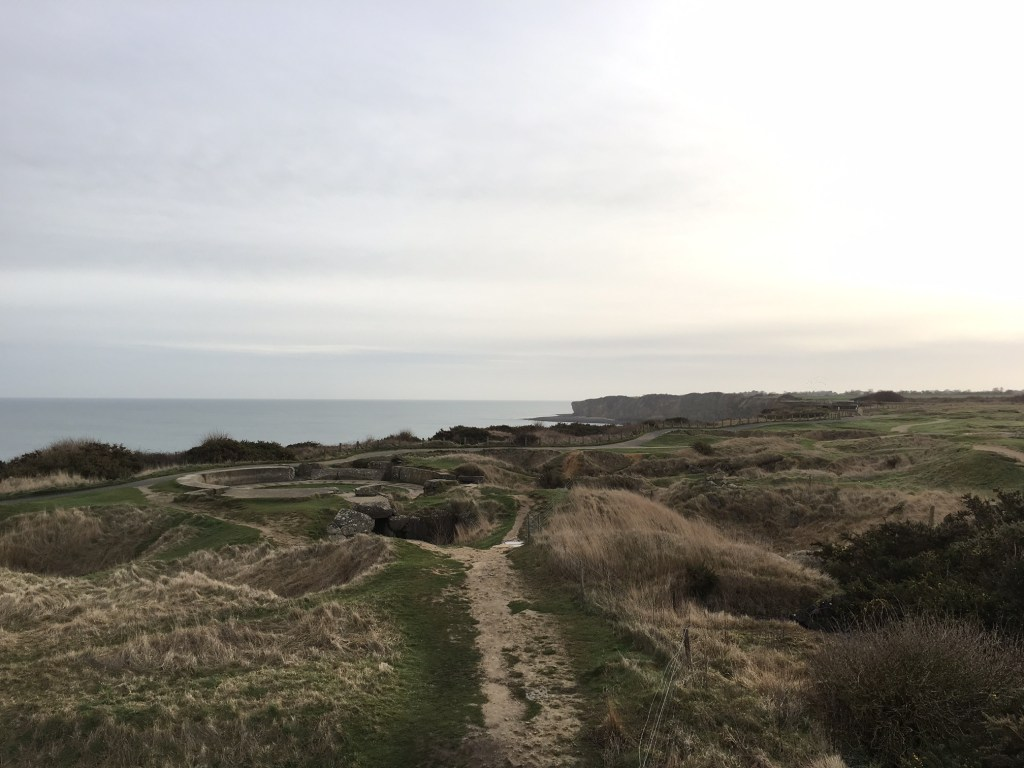 Pointe du Hoc on our tour of Normandy beaches. Those are bomb craters.