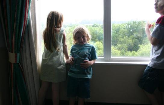 The children looking out the hotel window