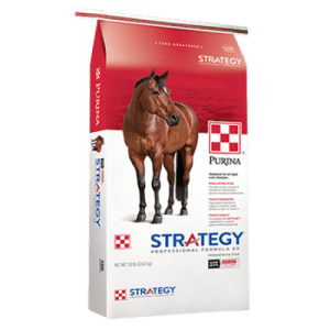 Purina Strategy Professional Formula GX. Red and white feed bag. Brown horse.