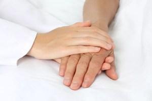 Patient hand in bed
