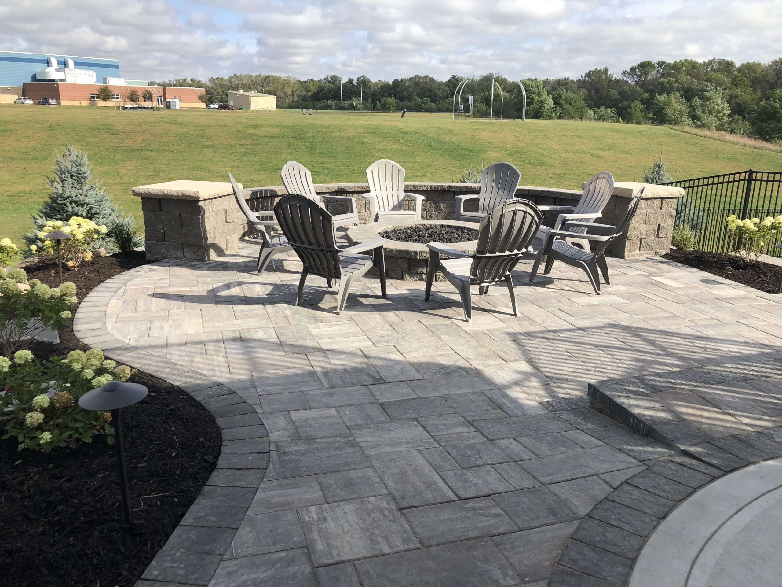 Patios Patera Landscaping Omaha Nebraska   Patio With Stairs From House   Concrete Slab   Simple   Back Yard   Composite Decking   Main Entrance Stamped Concrete Front