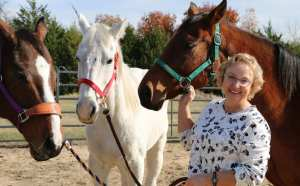 smiling woman at horse therapy