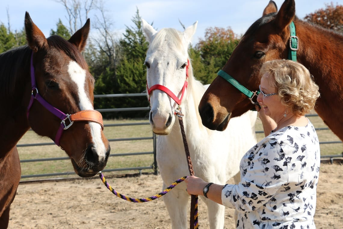 equine assisted therapist and her horses