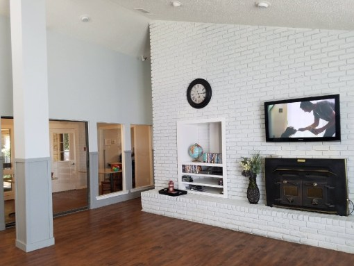 fireplace and tv in white living room