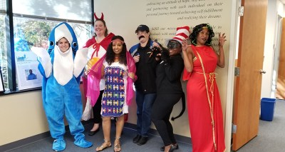 staff dressed up for Halloween