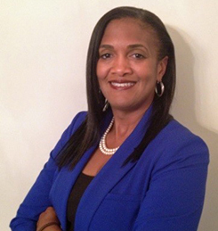 Executive Director Sylisa Lamber-Woodard smiling