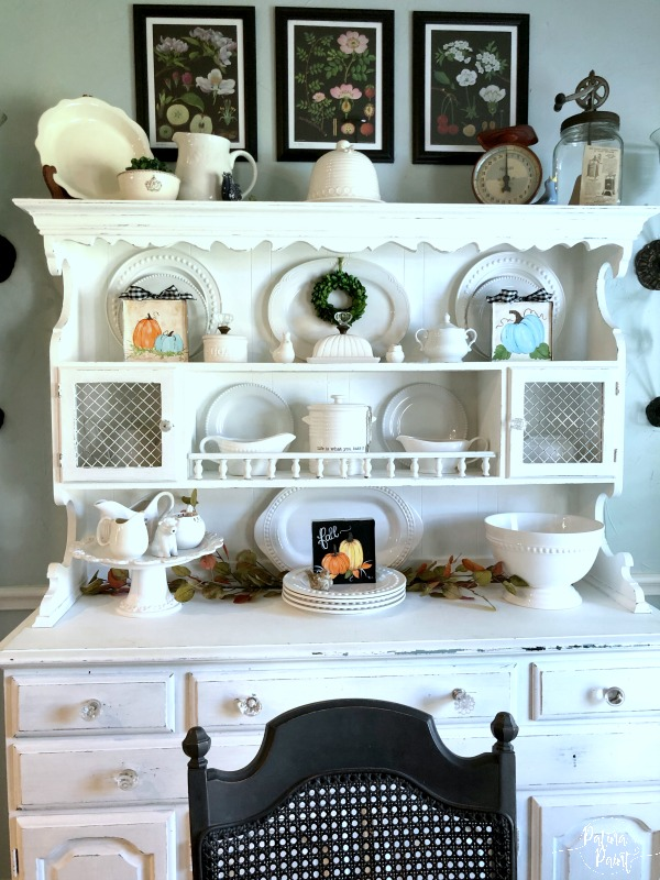 china hutch with fall decor