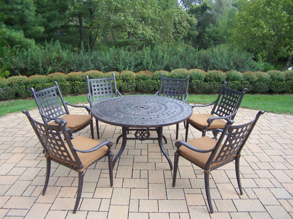 belmont aluminum 7 pc patio dining set includes 54 inch round table 6 stackable chairs with fade and mildew resistant sunbrella fabric cushions