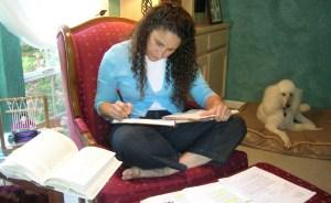 Patti writing in lap