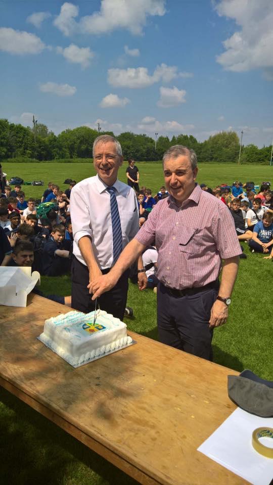 Mr O'Leary & Bish principal Mr Ciaran Doyle, cut the latter's retirement cake...