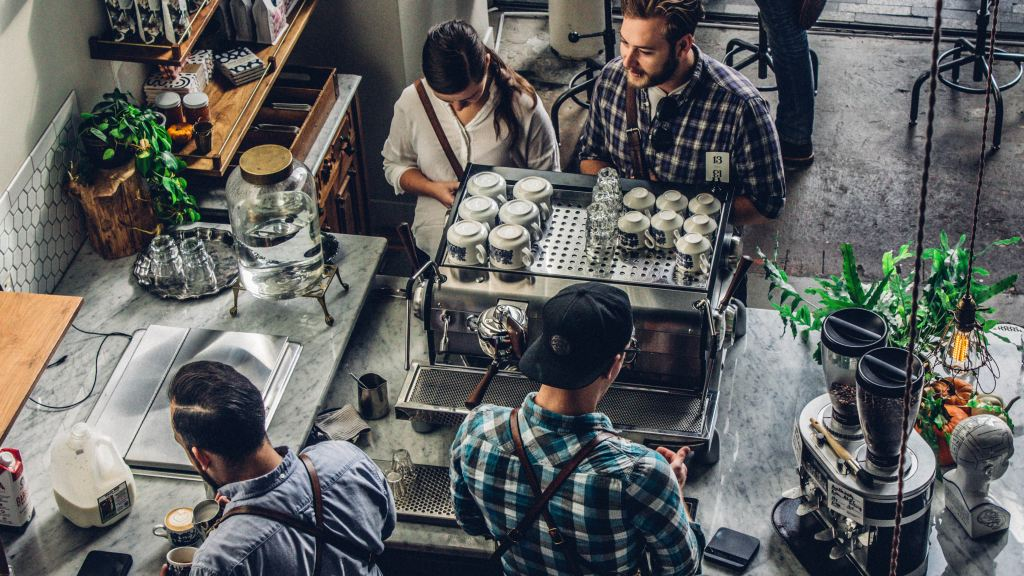 A birds-eye view to observe baristas making drinks in a coffee shop.