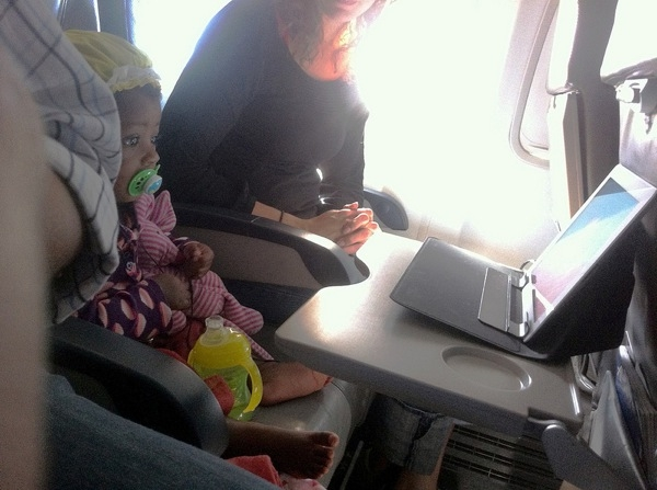 Zelda watches a video on the flight home