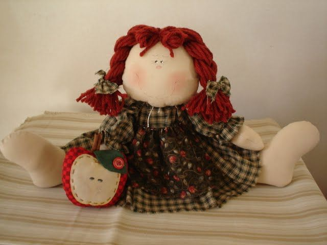 muñeca de trapo sentada