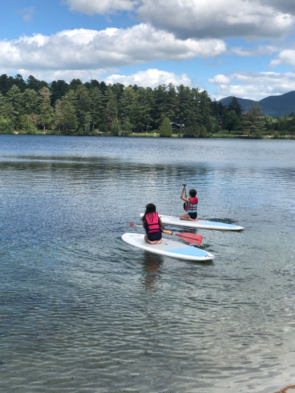 Paddleboarding on Mirror Lake Lake Placid #paddleboard #mirrorlake #lakeplacid #upstateNY #adirondacks