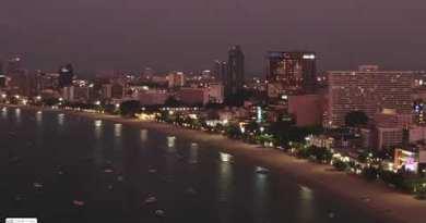 Pattaya coastline Night Video, Vacationers at Pattaya Seaside, Chonburi, Thailand. 4K Shooting With Drone.