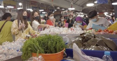 Browsing at Naklua Native Thai Seafood Market in Pattaya, Thailand. New Lobsters, Crabs and Oysters