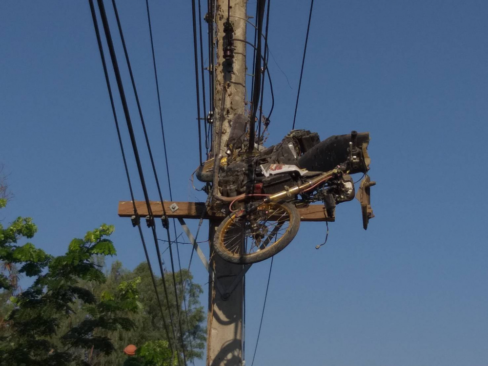 'Flying' motorbike ends up stuck in power lines in Surin