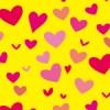 黄色背景にピンクのハートが散らばるパターン