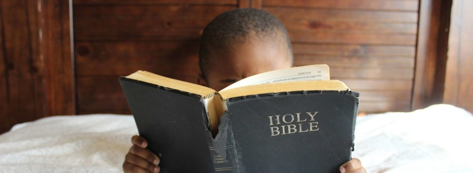 boy reading bible