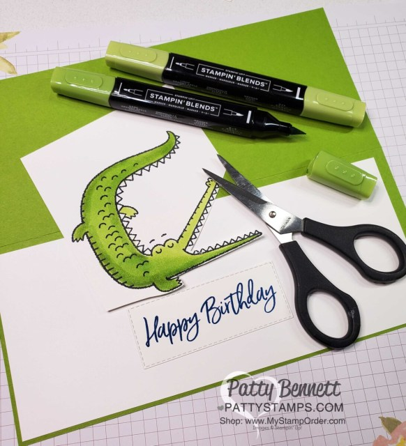 Stamp alligator image from the Oh Snap set and color with Granny Apple Green Stampin' Blends markers. Cut alligator in 2 pieces for the card front.