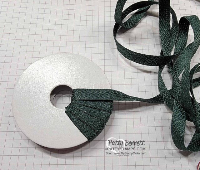 Wrap an empty ribbon spool with ribbon to make Cute Christmas Wreath Ornament with the Stampin' Up! Tidings and Trimmings bundle. DIY Christmas Craft idea!